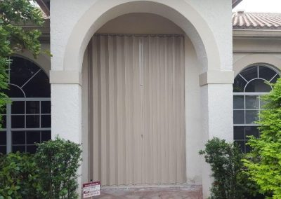 Beige_Accordion_Shutters_Door