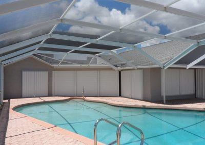 Shutter Pros Accordion Shutters Poolside White
