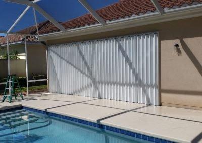 Shutter Pros Accordion Shutters Poolside White Shutters Sliding Glass Door