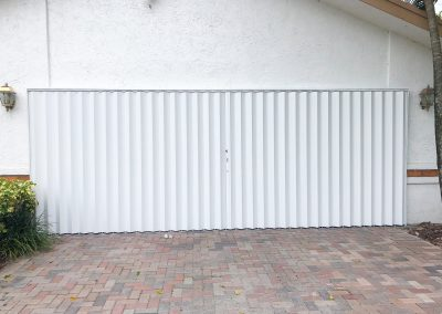 White Accordion Shutters_Garage_Closed