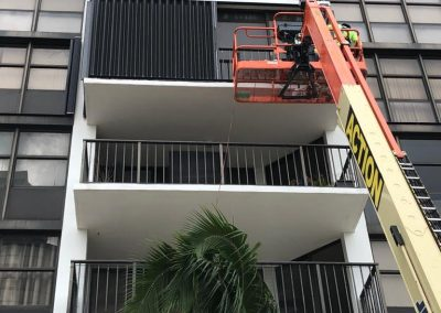 High Rise Building Accordion Shutters Bronze